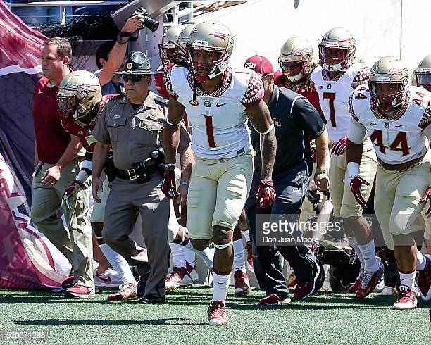 Wide Receiver Ermon Lane of the Florida State Seminoles leads the team on the field before the start of the Spring Game at the Florida Citrus Bowl in...