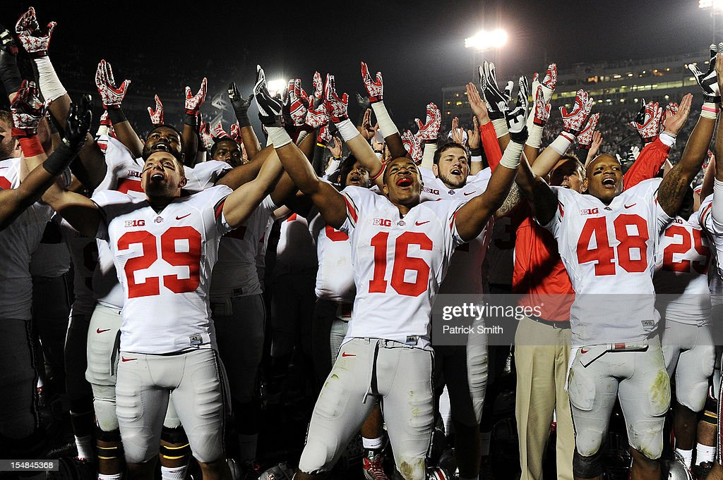 Wide receiver Evan Spencer #16 of the Ohio State Buckeyes and teammates celebrate after defeating the Penn State Nittany Lions at Beaver Stadium on October 27, 2012 in State College, Pennsylvania. The Ohio State Buckeyes won 35-23.