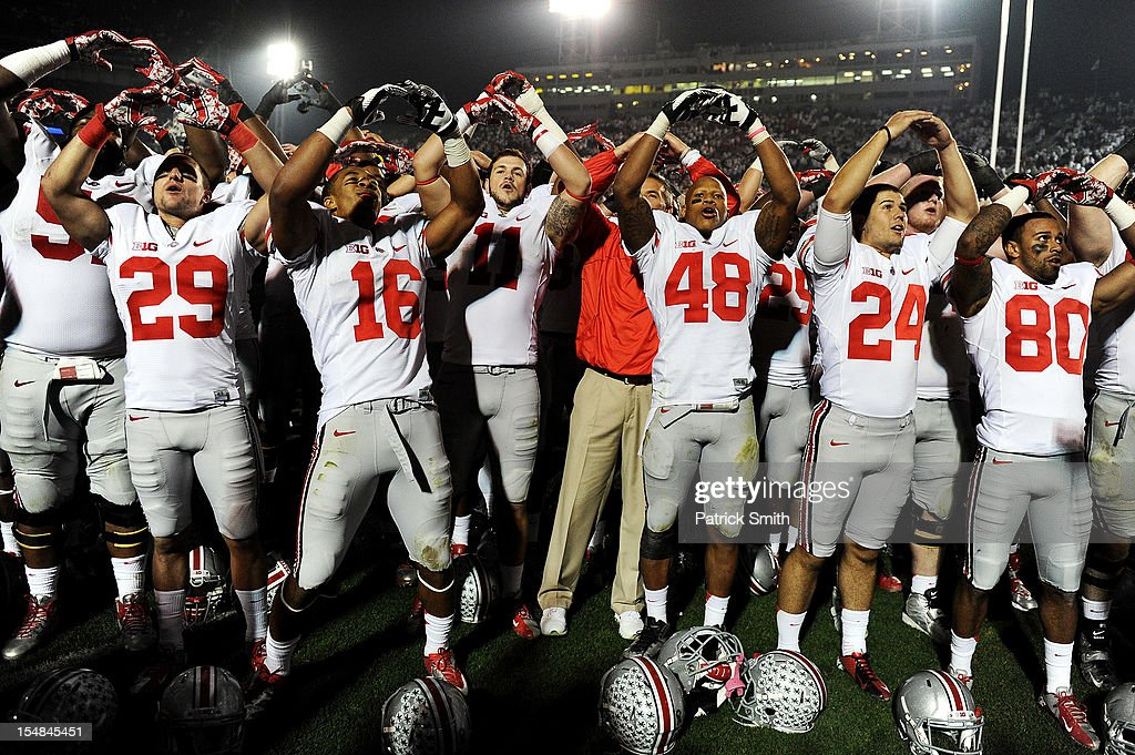 Wide receiver Evan Spencer #16 of the Ohio State Buckeyes and teammates celebrate after defeating the Penn State Nittany Lions at Beaver Stadium on October 27, 2012 in State College, Pennsylvania. The Ohio State Buckeyes won, 35-23.