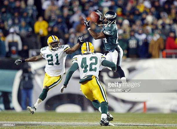 Wide receiver Freddie Mitchell of the Philadelphia Eagles catches a 28yard catch on defensive backs Jue Bhawoh and Darren Sharper of the Green Bay...