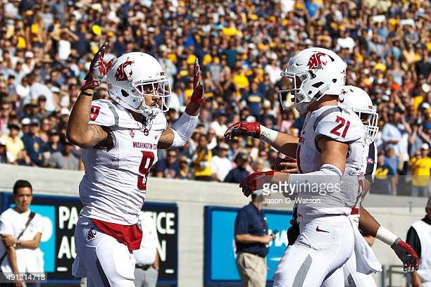 Wide receiver Gabe Marks of the Washington State Cougars celebrates with wide receiver River Cracraft after scoring a touchdown against the...