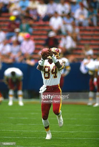 Wide Receiver Gary Clark of the Washington Redskins catches a pass in pregame warm ups before an NFL football game against the Houston Oilers at RFK...