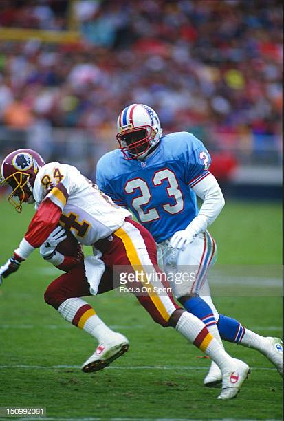 Wide Receiver Gary Clark of the Washington Redskins looks to run by Richard Johnson of the Houston Oilers during an NFL football game at RFK Stadium...