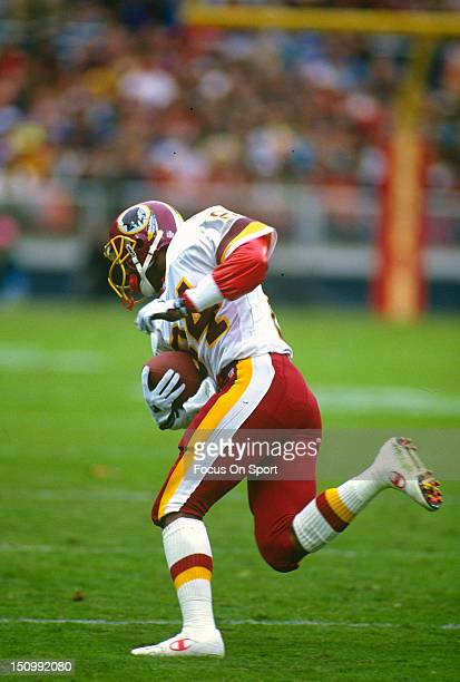 Wide Receiver Gary Clark of the Washington Redskins runs with the ball after a catch against the Houston Oilers during an NFL football game at RFK...