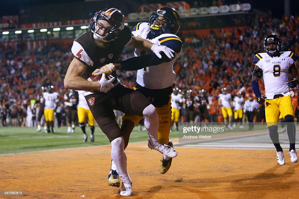 Wide receiver Gehrig Dieter #4 of the Bowling Green Falcons catches a pass in the end zone for a touchdown while being defended by cornerback Cheatham Norrils #1 of the Toledo Rockets during the third quarter at Doyt Perry Stadium on November 17, 2015 in Bowling Green, Ohio.