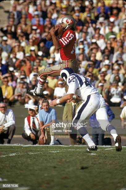 Wide receiver Gene Washington of the San Francisco 49ers catches a pass in front of defensive back Dave Elmendorf of the Los Angeles Rams at the Los...