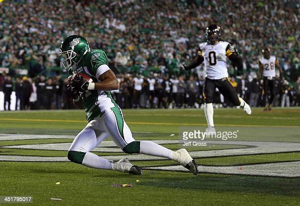 Wide receiver Geroy Simon of the Saskatchewan Roughriders catches a touchdown pass against the Hamilton TigerCats in the first quarter during the...