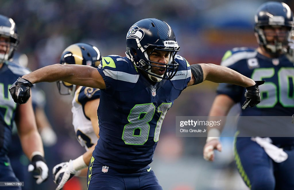 Wide receiver <a gi-track='captionPersonalityLinkClicked' href=/galleries/search?phrase=Golden+Tate&family=editorial&specificpeople=4500989 ng-click='$event.stopPropagation()'>Golden Tate</a> #81 of the Seattle Seahawks reacts after rushing for a long gain against the St. Louis Rams at CenturyLink Field on December 30, 2012 in Seattle, Washington. The Seahawks defeated the Rams 20-13.