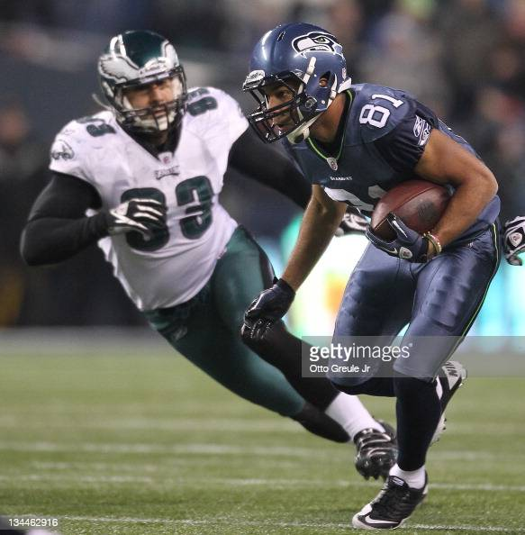 Wide receiver Golden Tate of the Seattle Seahawks rushes against Jason Babin of the Philadelphia Eagles at CenturyLink Field on December 1 2011 in...