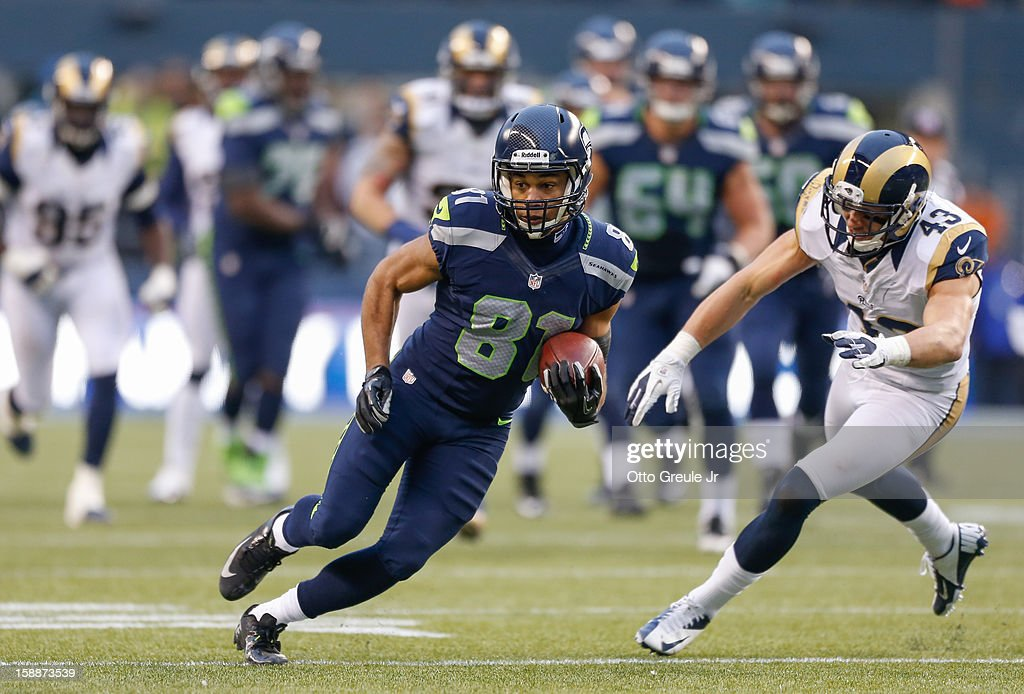 Wide receiver Golden Tate #81 of the Seattle Seahawks rushes against strong safety Craig Dahl #43 of the St. Louis Rams at CenturyLink Field on December 30, 2012 in Seattle, Washington.