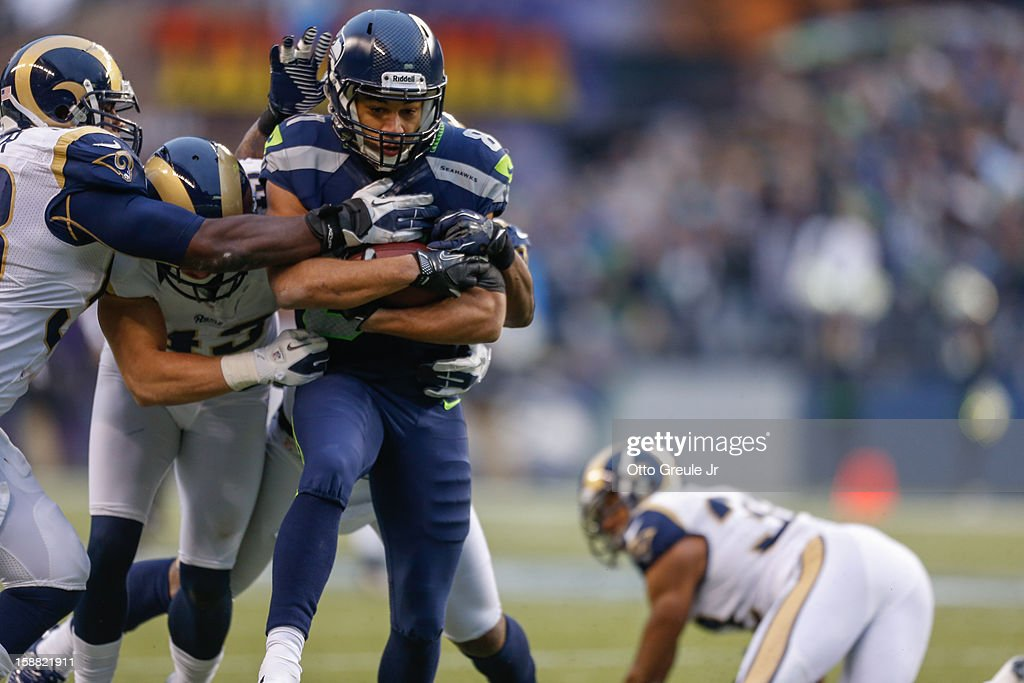 Wide receiver Golden Tate #81 of the Seattle Seahawks rushes against the St. Louis Rams at CenturyLink Field on December 30, 2012 in Seattle, Washington. The Seahawks defeated the Rams 20-13.