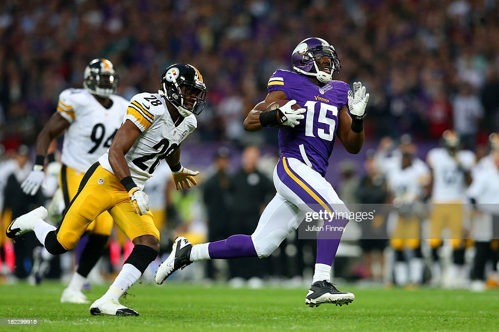 Wide receiver <a gi-track='captionPersonalityLinkClicked' href=/galleries/search?phrase=Greg+Jennings+-+American+Football+Player&family=editorial&specificpeople=2117148 ng-click='$event.stopPropagation()'>Greg Jennings</a> #15 of the Minnesota Vikings outpaces cornerback <a gi-track='captionPersonalityLinkClicked' href=/galleries/search?phrase=Cortez+Allen&family=editorial&specificpeople=5516860 ng-click='$event.stopPropagation()'>Cortez Allen</a> #28 of the Pittsburgh Steelers turnover score a 70yd touchdown during the NFL International Series game between Pittsburgh Steelers and Minnesota Vikings at Wembley Stadium on September 29, 2013 in London, England.