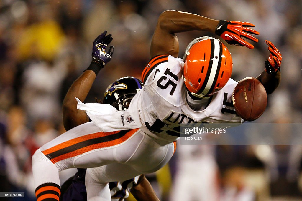 Wide receiver Greg Little #15 of the Cleveland Browns drops the pass in the fourth quarter against cornerback <a gi-track='captionPersonalityLinkClicked' href=/galleries/search?phrase=Lardarius+Webb&family=editorial&specificpeople=5735454 ng-click='$event.stopPropagation()'>Lardarius Webb</a> #21 of the Baltimore Ravens during the NFL Game at M&T Bank Stadium on September 27, 2012 in Baltimore, Maryland.