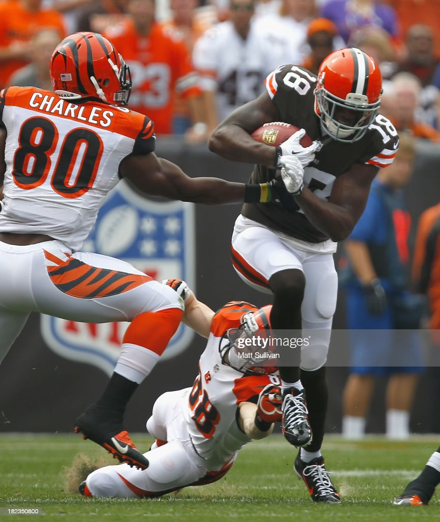 Wide receiver Greg Little #18 of the Cleveland Browns runs by defenders Orson Charles #80 and Ryan Whalen #88 of the Cincinnati Bengals at FirstEnergy Stadium on September 29, 2013 in Cleveland, Ohio.