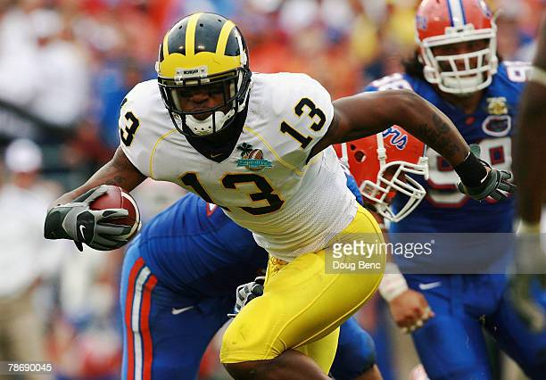 Wide receiver Greg Mathews of the Michigan Wolverines looks for room to run against the Florida Gators in the Capital One Bowl at Florida Citrus Bowl...
