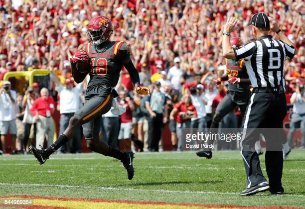 Wide receiver Hakeem Butler of the Iowa State Cyclones runs into the end zone uncontested to score a touchdown in the second half of play against the...