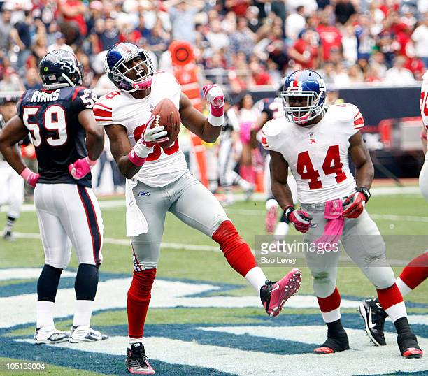 Wide receiver Hakeem Nicks celebrates with Ahmad Bradshaw after scoring on a passs in the second quarter at Reliant Stadium on October 10 2010 in...