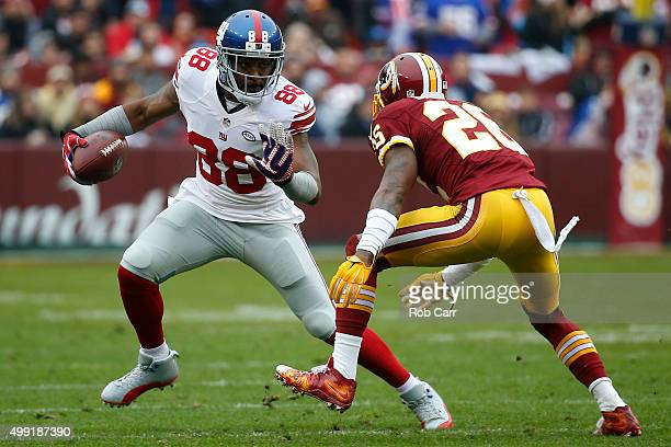 Wide receiver Hakeem Nicks of the New York Giants carries the ball against cornerback Bashaud Breeland of the Washington Redskins in the first...