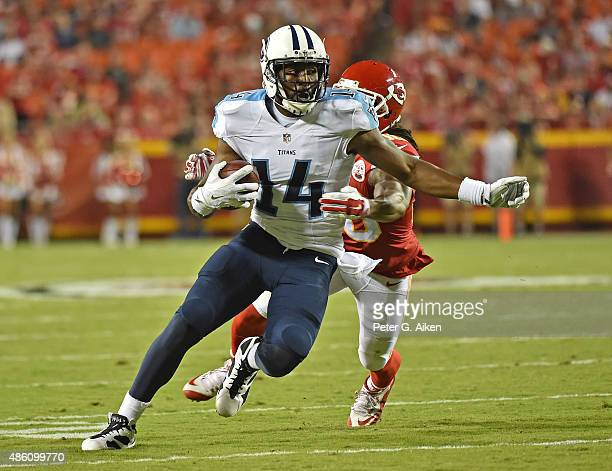Wide receiver Hakeem Nicks of the Tennessee Titans runs up field against defensive back Jamell Fleming of the Kansas City Chiefs during the first...