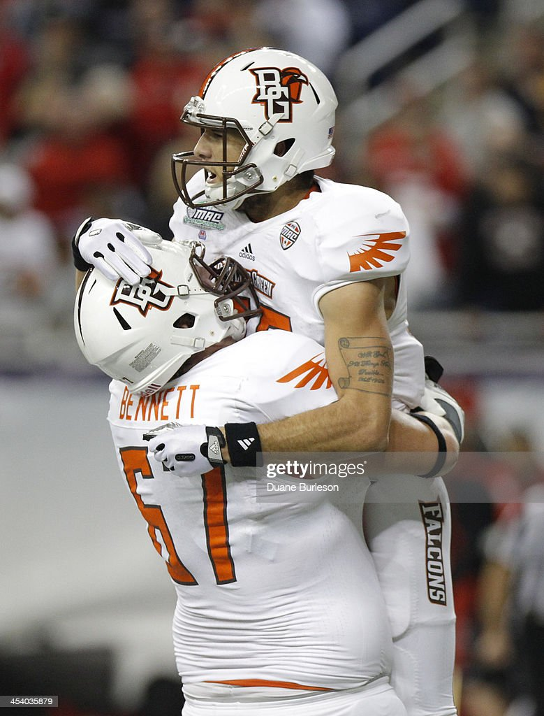 Wide receiver Heath Jackson of the Bowling Green Falcons celebrates in the arms of offensive linesman Jacob Bennett after a second quarter touchdown...