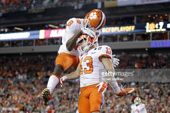 Wide receiver Hunter Renfrow of the Clemson Tigers celebrates with wide receiver Deon Cain after catching a 24yard touchdown pass during the third...