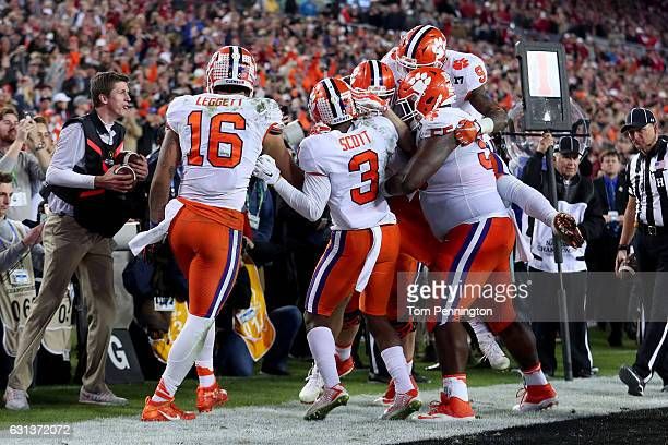 Wide receiver Hunter Renfrow of the Clemson Tigers celebrates with teammates after making a 2yard gamewinning touchdown reception against defensive...
