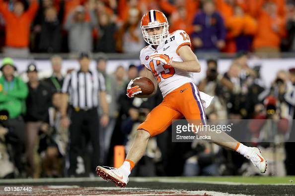 Wide receiver Hunter Renfrow of the Clemson Tigers reacts after catching a 24yard touchdown pass during the third quarter against the Alabama Crimson...