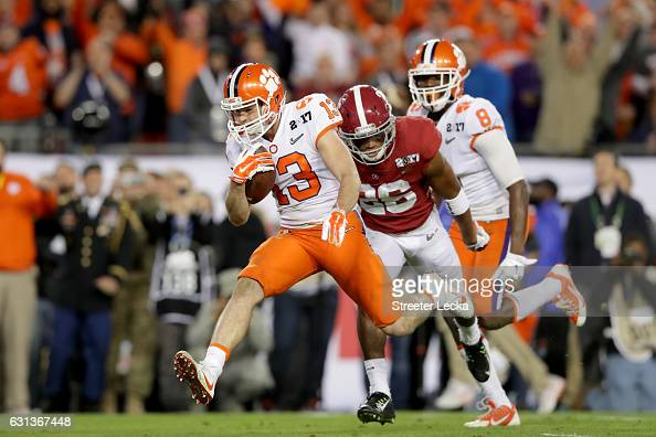 Wide receiver Hunter Renfrow of the Clemson Tigers runs after catching a 24yard touchdown pass during the third quarter against the Alabama Crimson...