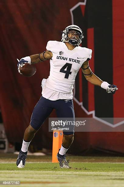 Wide receiver Hunter Sharp of the Utah State Aggies celebrates a touchdown in the second quarter against the San Diego State Aztecs at Qualcomm...