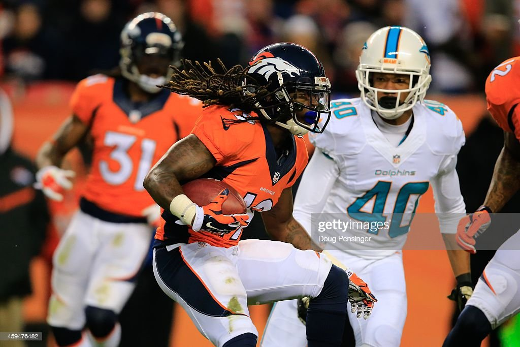 Wide receiver <a gi-track='captionPersonalityLinkClicked' href=/galleries/search?phrase=Isaiah+Burse&family=editorial&specificpeople=7228109 ng-click='$event.stopPropagation()'>Isaiah Burse</a> #19 of the Denver Broncos returns a punt against the Miami Dolphins at Sports Authority Field at Mile High on November 23, 2014 in Denver, Colorado.