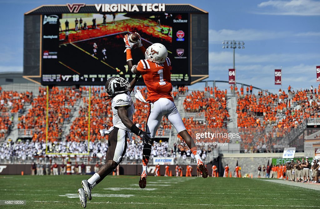 Wide receiver Isaiah Ford #1 of the Virginia Tech Hokies makes a touchdown catch while being defended by cornerback Ronald Zamort #7 of the Western Michigan Broncos in the second half at Lane Stadium on September 27, 2014 in Blacksburg, Virginia. Virginia Tech defeated Western Michigan 35-17.