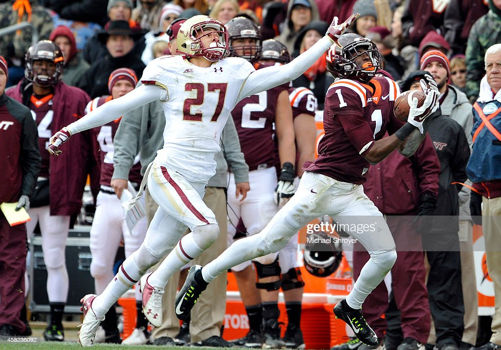 Wide receiver Isaiah Ford #1 of the Virginia Tech Hokies makes a reception near the sideline while being defended by defensive back Justin Simmons #27 of the Boston College Eagles in the second half at Lane Stadium on November 1, 2014 in Blacksburg, Virginia. Boston College defeated Virginia Tech 33-31.