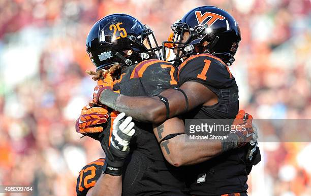 Wide receiver Isaiah Ford of the Virginia Tech Hokies reacts following his touchdown reception with tight end Bucky Hodges in the second half against...