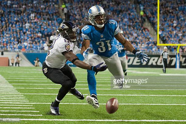 Wide receiver Jacoby Jones of the Baltimore Ravens misses a catch while under pressure from cornerback Rashean Mathis of the Detroit Lions during the...