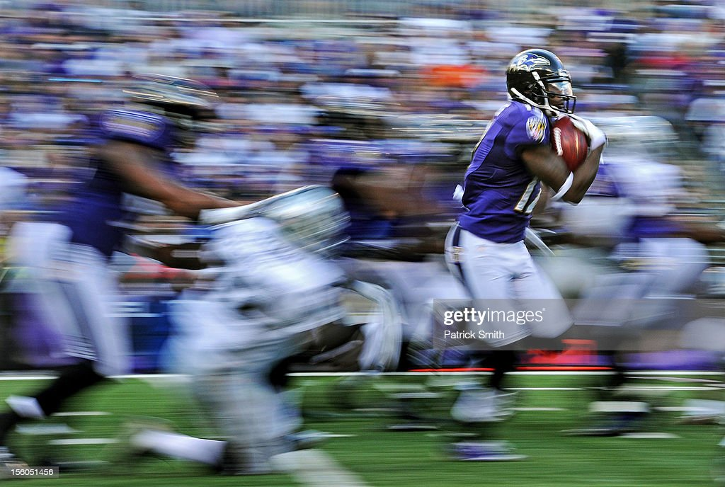 Wide receiver <a gi-track='captionPersonalityLinkClicked' href=/galleries/search?phrase=Jacoby+Jones&family=editorial&specificpeople=4167942 ng-click='$event.stopPropagation()'>Jacoby Jones</a> #12 of the Baltimore Ravens returns a 105-yard kick-off return for a touchdown against the Oakland Raiders in the fourth quarter at M&T Bank Stadium on November 11, 2012 in Baltimore, Maryland. The Baltimore Ravens won, 55-20.