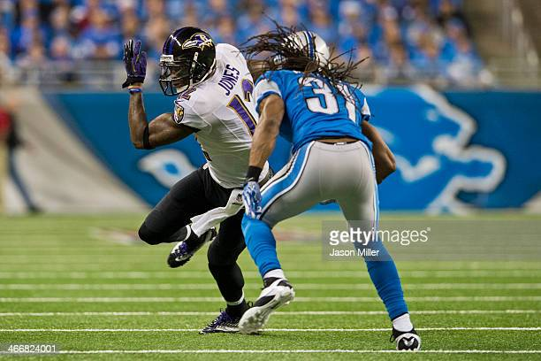 Wide receiver Jacoby Jones of the Baltimore Ravens runs for a gain while under pressure from cornerback Rashean Mathis of the Detroit Lions during...