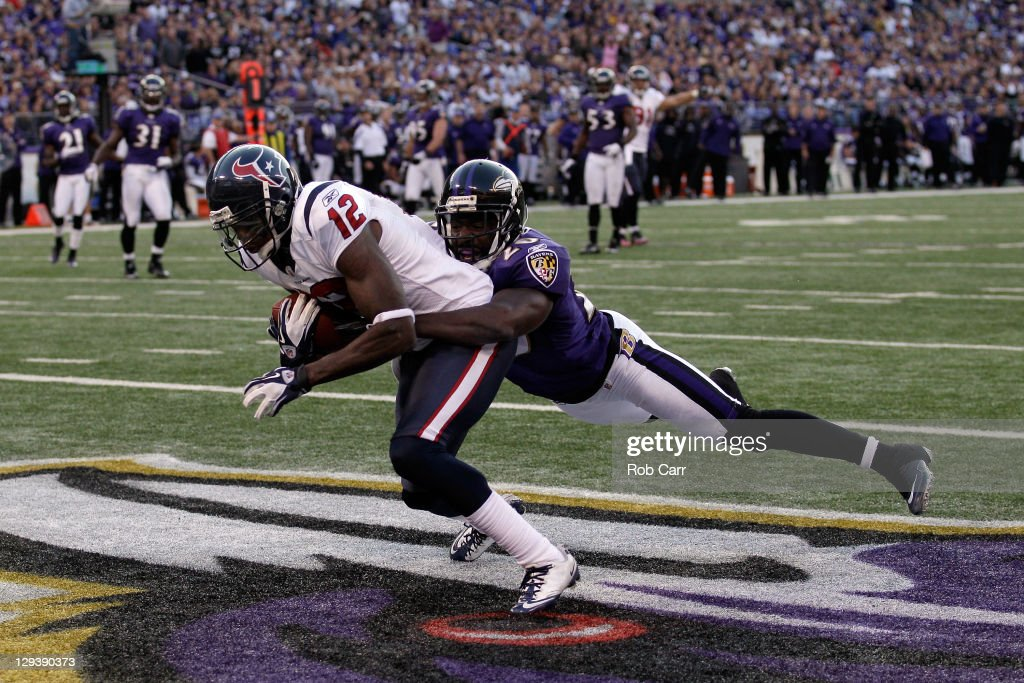 Wide receiver Jacoby Jones #12 of the Houston Texans catches a touchdown pass in front of defender Ed Reed #20 of the Baltimore Ravens during the second half at M&T Bank Stadium on October 16, 2011 in Baltimore, Maryland.