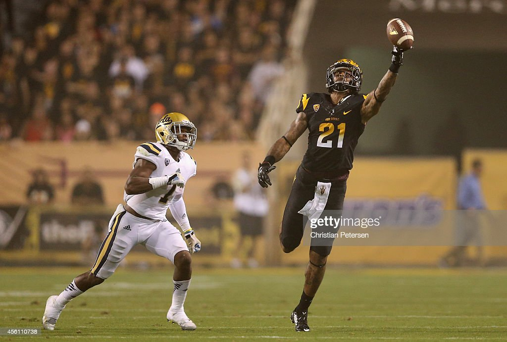 Wide receiver <a gi-track='captionPersonalityLinkClicked' href=/galleries/search?phrase=Jaelen+Strong&family=editorial&specificpeople=11339116 ng-click='$event.stopPropagation()'>Jaelen Strong</a> #21 of the Arizona State Sun Devils attempts to make a catch on an incomplete pass over defensive back John Johnson #7 of the UCLA Bruins during the college football game at Sun Devil Stadium on September 25, 2014 in Tempe, Arizona.