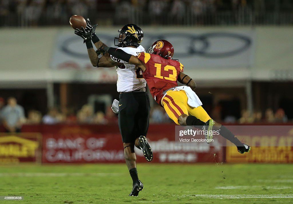 Wide receiver <a gi-track='captionPersonalityLinkClicked' href=/galleries/search?phrase=Jaelen+Strong&family=editorial&specificpeople=11339116 ng-click='$event.stopPropagation()'>Jaelen Strong</a> #21 of the Arizona State Sun Devils catches the ball for a reception as cornerback Kevon Seymour #13 of the USC Trojans can't defend the play in the fourth quarter at Los Angeles Memorial Coliseum on October 4, 2014 in Los Angeles, California. The Sun Devils defeated the Trojans 38-34.