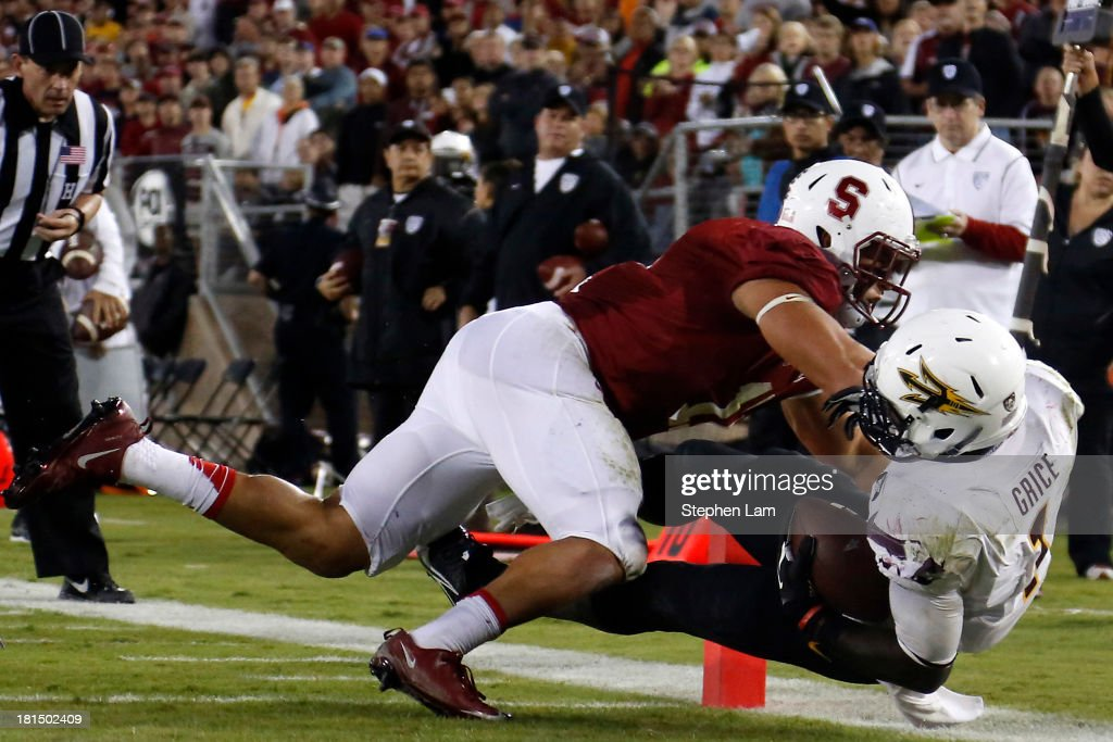 Wide receiver Jaelen Strong #21 of the Arizona State Sun Devils dives for a touchdown as linebacker Shayne Skov #11 of the Stanford Cardinal defends during the fourth quarter t at Stanford Stadium on September 21, 2013 in Stanford, California. The Cardinals defeated the Sun Devils 42-28.