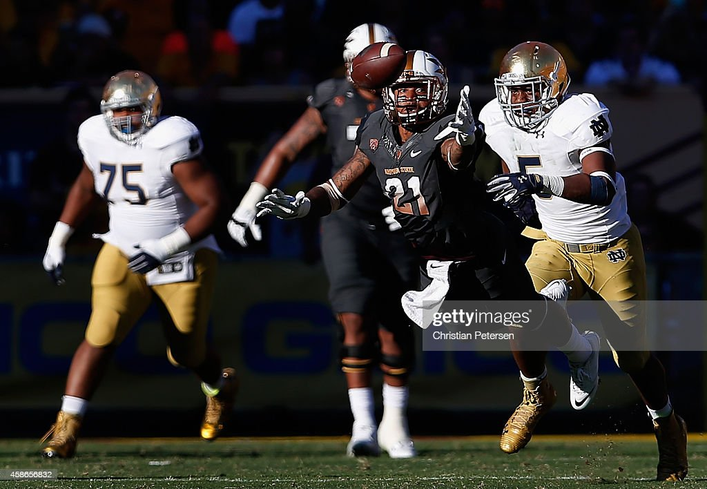 Wide receiver <a gi-track='captionPersonalityLinkClicked' href=/galleries/search?phrase=Jaelen+Strong&family=editorial&specificpeople=11339116 ng-click='$event.stopPropagation()'>Jaelen Strong</a> #21 of the Arizona State Sun Devils is unable to catch a pass ahead of linebacker Nyles Morgan #5 of the Notre Dame Fighting Irish during the third quarter of the college football game at Sun Devil Stadium on November 8, 2014 in Tempe, Arizona. The Sun Devils defeated the Fighting Irish 55-31.