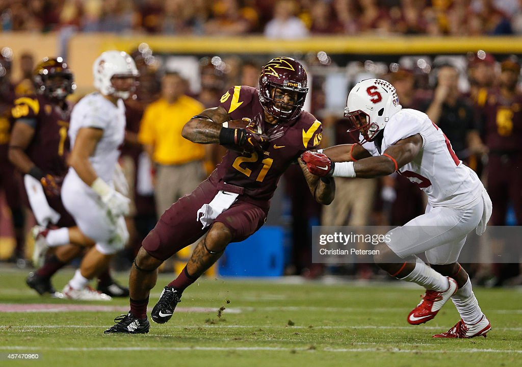 Wide receiver <a gi-track='captionPersonalityLinkClicked' href=/galleries/search?phrase=Jaelen+Strong&family=editorial&specificpeople=11339116 ng-click='$event.stopPropagation()'>Jaelen Strong</a> #21 of the Arizona State Sun Devils runs with the football after a reception against cornerback <a gi-track='captionPersonalityLinkClicked' href=/galleries/search?phrase=Alex+Carter+-+American+Football+Player&family=editorial&specificpeople=13969594 ng-click='$event.stopPropagation()'>Alex Carter</a> #25 of the Stanford Cardinal during the fourth quarter of the college football game at Sun Devil Stadium on October 18, 2014 in Tempe, Arizona. The Sun Devils defeated the Cardinal 26-10.