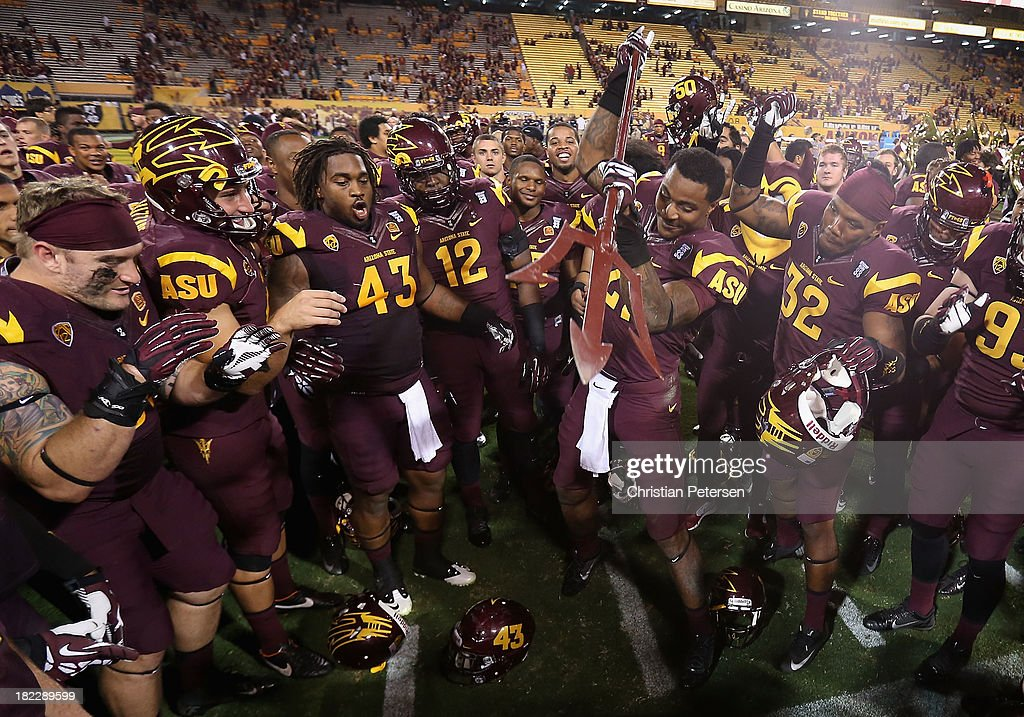 Wide receiver Jaelen Strong #21 of the Arizona State Sun Devils spikes the pitch fork in celebration after the college football game against the USC Trojans at Sun Devil Stadium on September 28, 2013 in Tempe, Arizona. The Sun Devils defeated the Trojans 62-41.