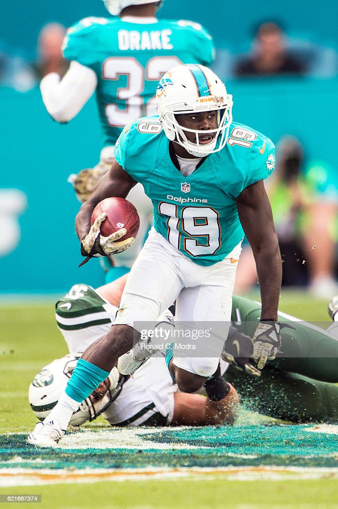 e11b9fcb8 Wide receiver Jakeem Grant 19 of the Miami Dolphins carries the ball during
