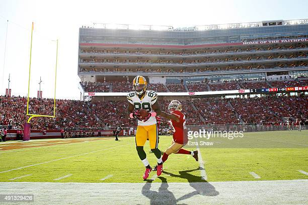 Wide receiver James Jones of the Green Bay Packers makes a catch at the sideline against the San Francisco 49ers during their NFL game at Levi's...