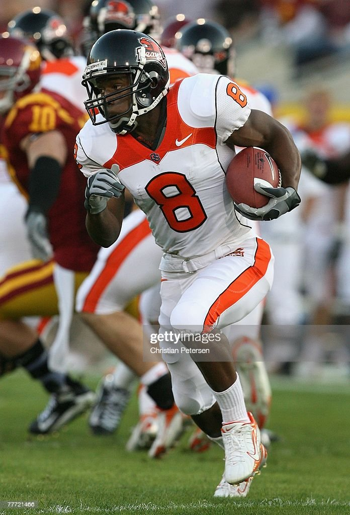 Wide receiver James Rodgers of the Oregon State Beavers runs with the football during the college football game against the USC Trojans at the Los...