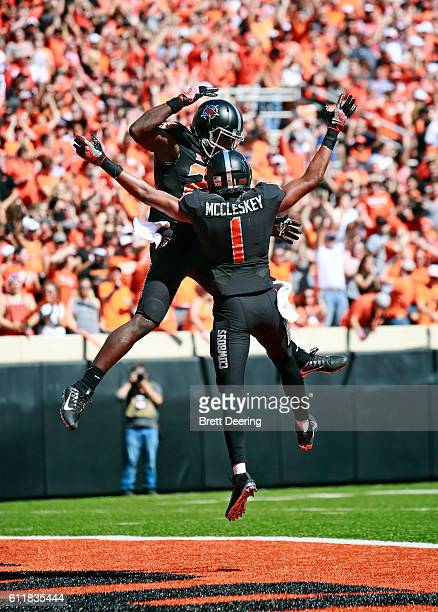 Wide receiver James Washington and wide receiver Jalen McCleskey of the Oklahoma State Cowboys celebrate a touchdown against the Texas Longhorns...