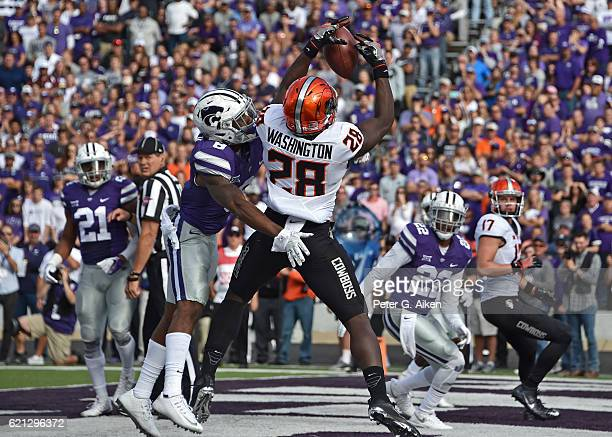 Wide receiver James Washington of the Oklahoma State Cowboys catches a touchdown pass against free safety Kendall Adams of the Kansas State Wildcats...