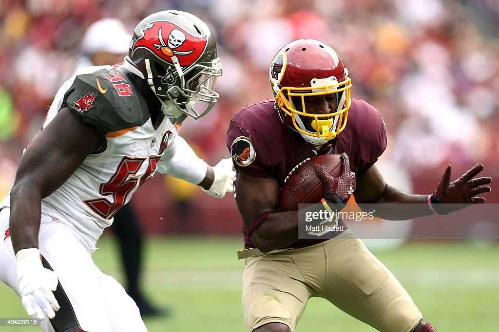 wide receiver <a gi-track='captionPersonalityLinkClicked' href=/galleries/search?phrase=Jamison+Crowder&family=editorial&specificpeople=8230117 ng-click='$event.stopPropagation()'>Jamison Crowder</a> #80 of the Washington Redskins carries the ball while defensive end <a gi-track='captionPersonalityLinkClicked' href=/galleries/search?phrase=Jacquies+Smith&family=editorial&specificpeople=5527838 ng-click='$event.stopPropagation()'>Jacquies Smith</a> #56 of the Tampa Bay Buccaneers defends in the third quarter of a game at FedExField on October 25, 2015 in Landover, Maryland.