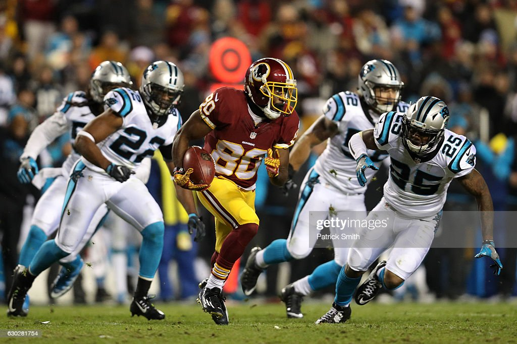 Wide receiver Jamison Crowder #80 of the Washington Redskins carries the ball against defensive back Lou Young #25 and free safety Michael Griffin #22 of the Carolina Panthers in the third quarter at FedExField on December 19, 2016 in Landover, Maryland.